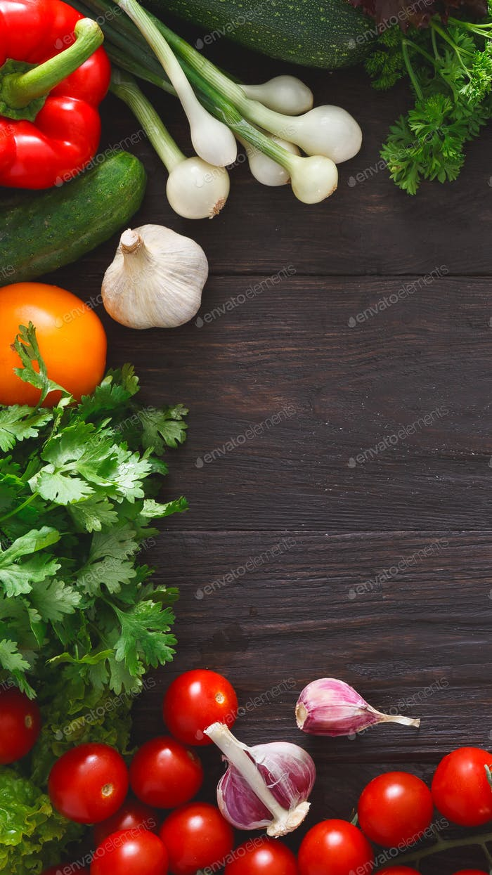 Frame of fresh vegetables on wooden background