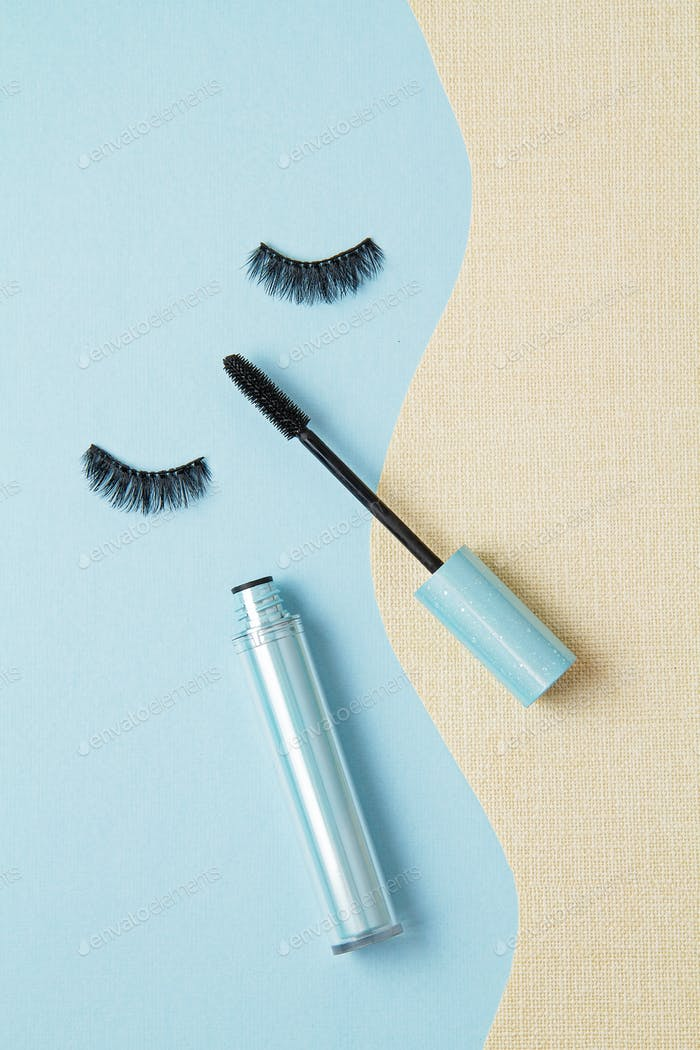 Top view of Mascara brush over the blue background