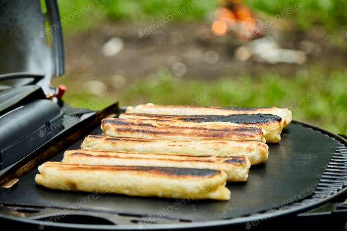 Grilled cheese puff pastry on the grill gas outdoor.