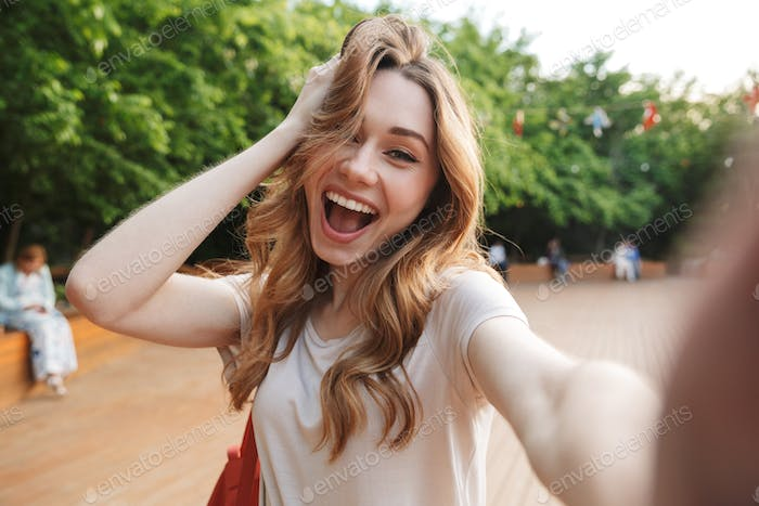 Close up of a cheerful young girl taking selfie