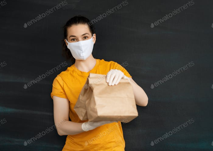 Delivery woman holding packages