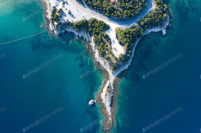 Aerial drone view of a remote rocky peninsula in Greece.