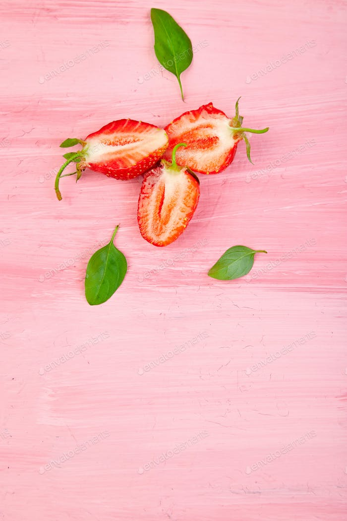 Strawberry and basil on pink background. Fruit frame.