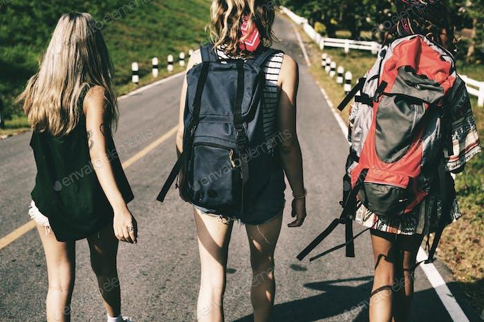 Diverse Backpacker Women Walking along The Street Side