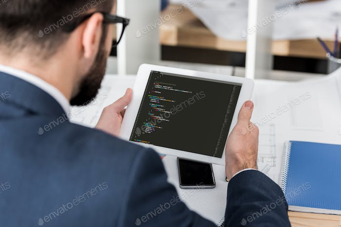 businessman holding tablet with loading system