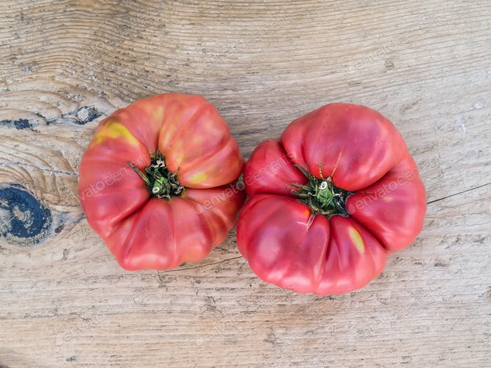 Ripe tomato on wooden desk