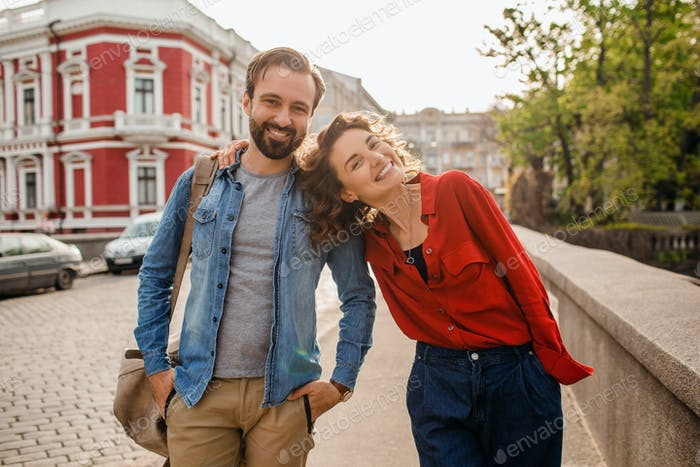 man and woman on romantic vacation walking together
