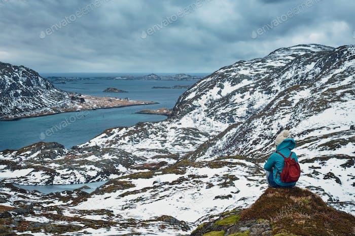 Woman tourist on Lofoten islands, Norway