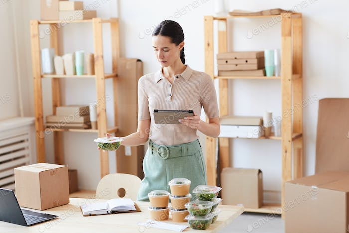 Woman organizing the food delivery