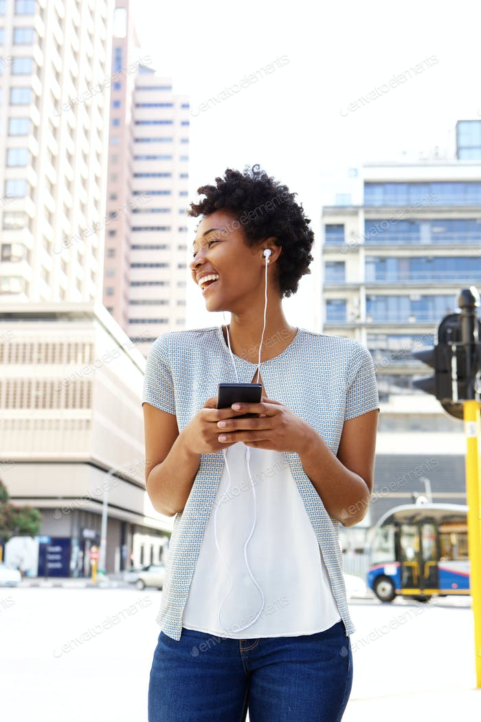 Woman enjoying listening to music on her mobile phone