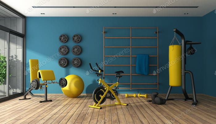 Blue home gym with black and yellow fitness equipment