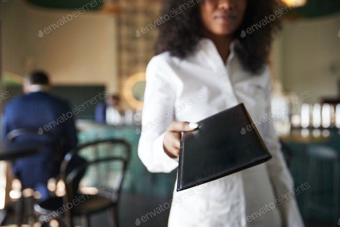 Thumbnail for Waiter In Busy Cocktail Bar Of Restaurant With Customers At Camera