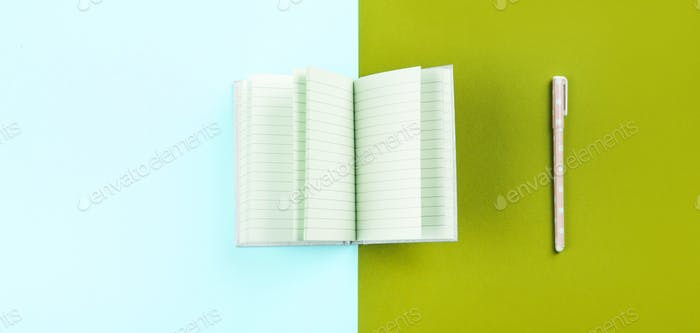 Duotone background with open notebook and pen