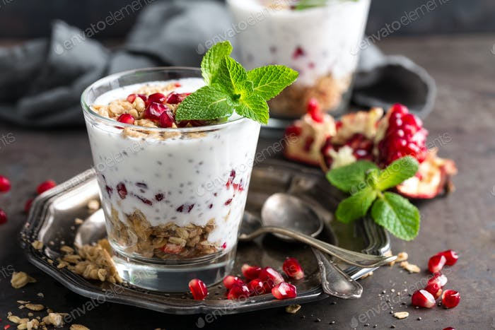 Chia pudding parfait with pomegranate, granola and light greek yogurt. Healthy eating