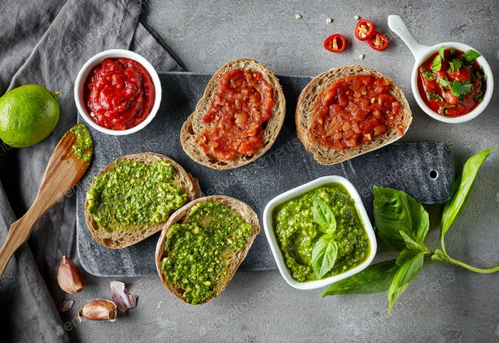 Bread slices with basil pesto and garlic tomato sauce
