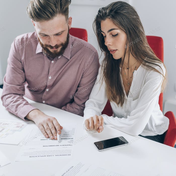 Couple Signing Mortgage Contract
