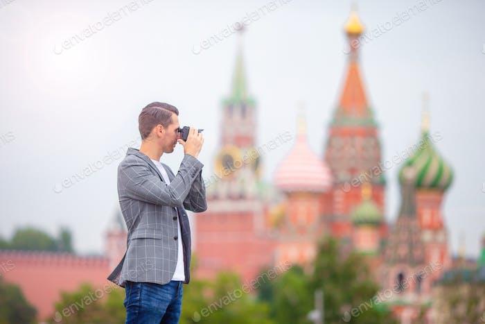 Professional photographer man taking a city photo
