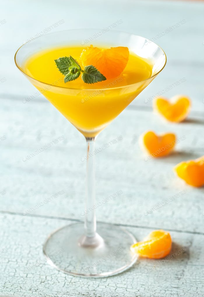 Cocktail glass with orange jelly dessert