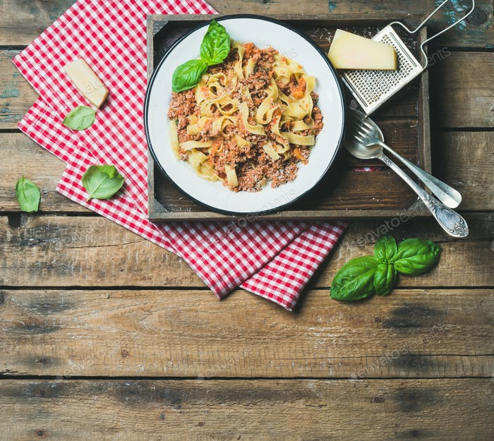 Tagliatelle Bolognese with Parmesan and Basil leaves, copy space