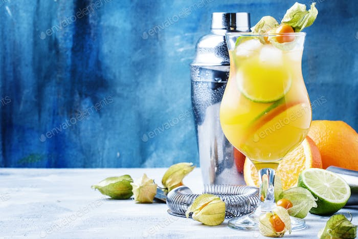 cocktail summer breeze with syrup, lime, orange, beer and ice
