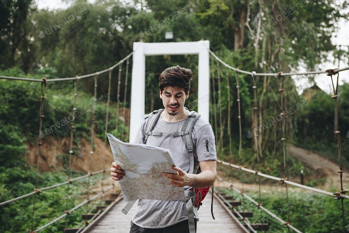 Caucasian man looking at a map travel and explore concept