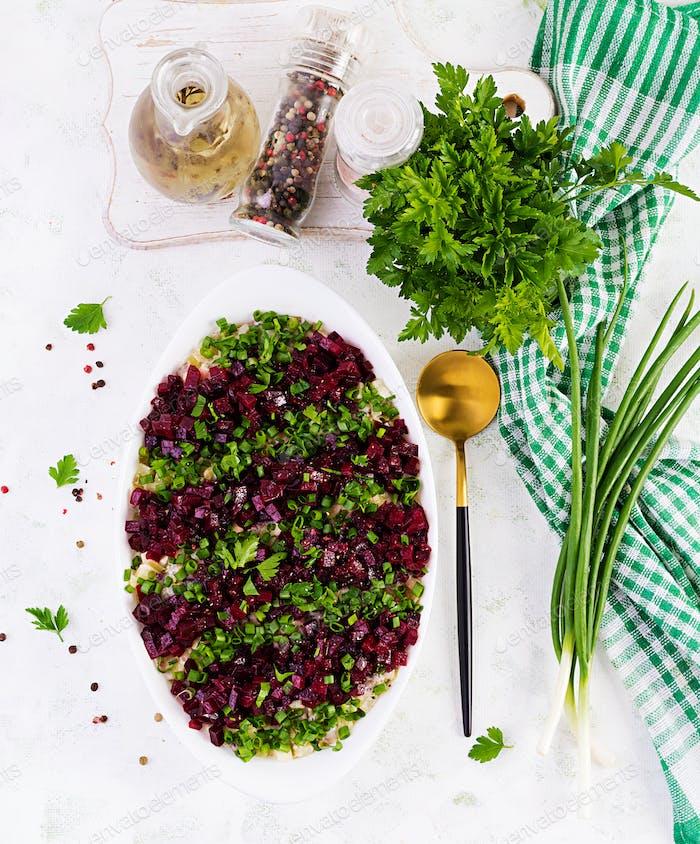 Kosher food, jewish salad. Herring,  pickled cucumber, beet, potato and apples salad