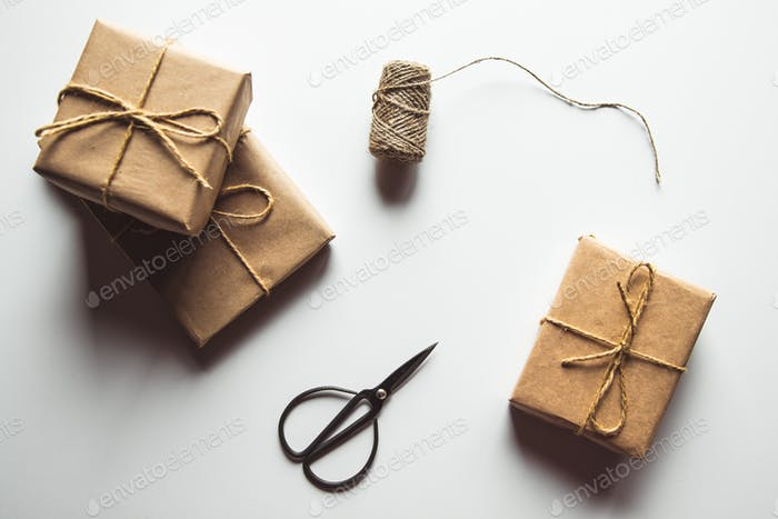wrapping gifts concept for holiday on white background top view mock up