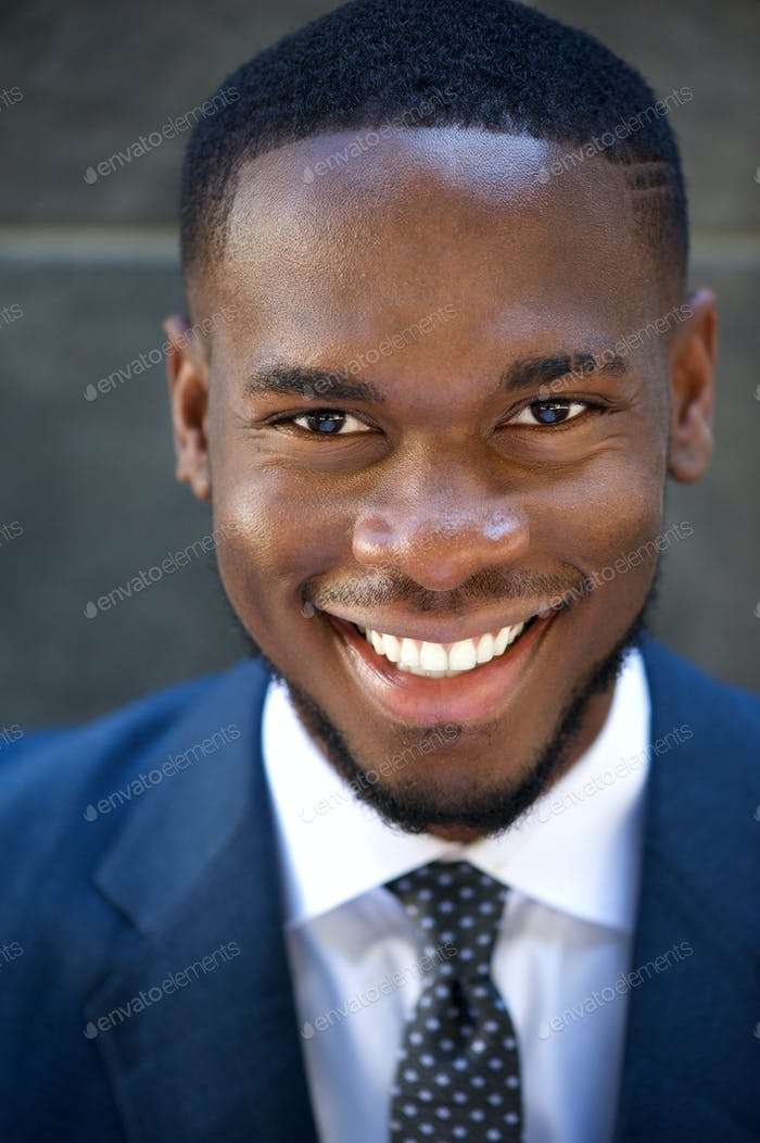 Happy friendly young businessman