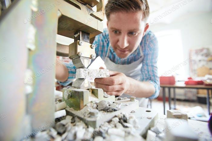 Craftsman Using Stone Splitting Machine