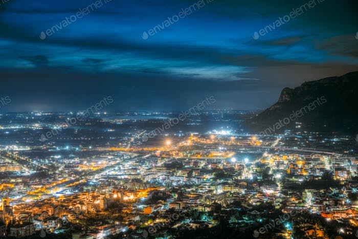 Terracina, Italy. Top Cityscape In Evening Night Illuminations