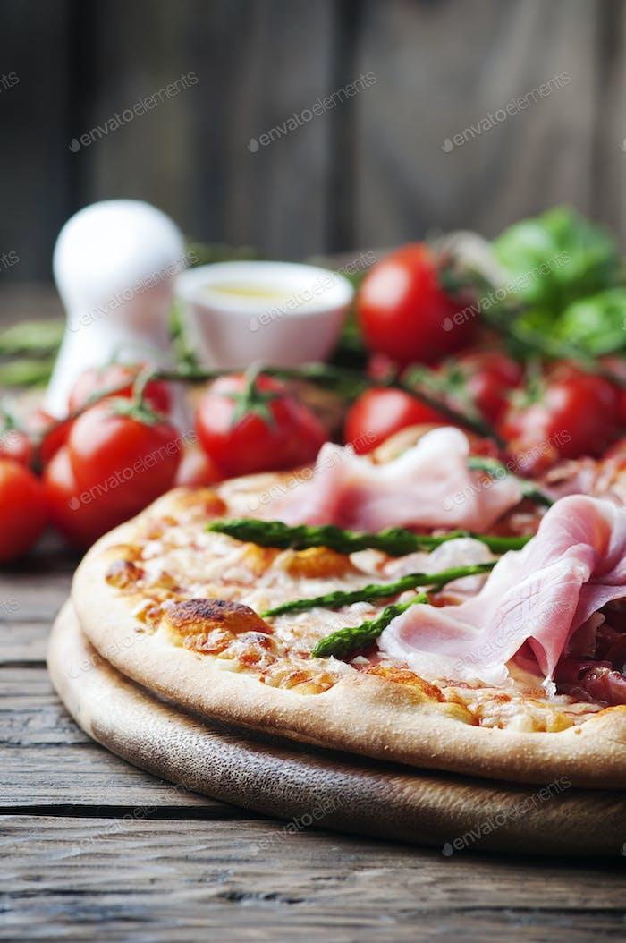 Italian pizza with ham and asparagus