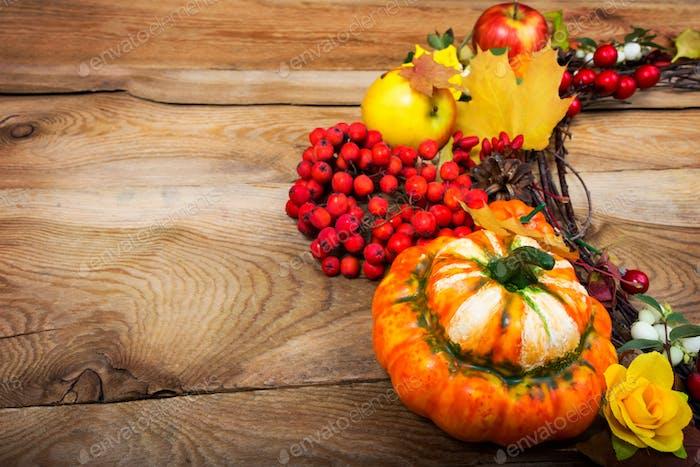 Fall pumpkins, rowan berries wreath, copy space