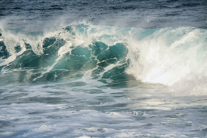 View of a scenic blue ocean wave