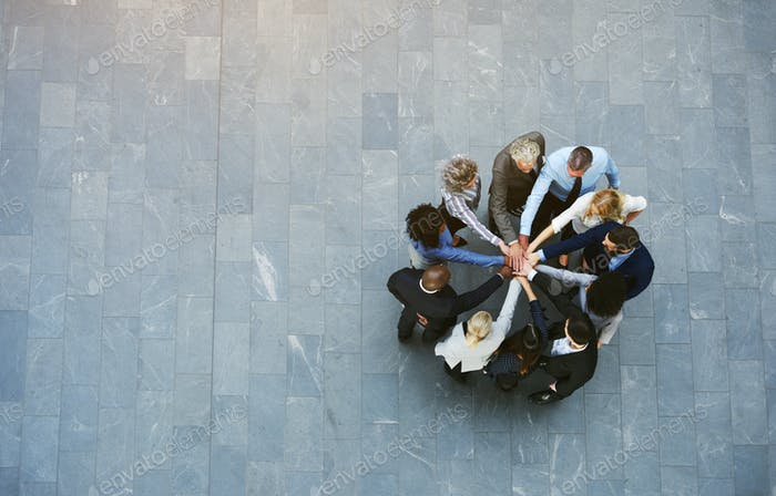 Multiracial business people having teambuilding with hands stacked