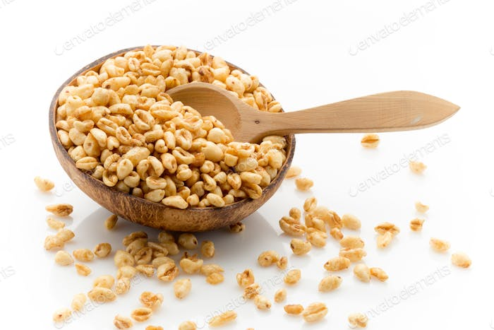 Corn flakes in a bowl isolated on a white background, studio photography.