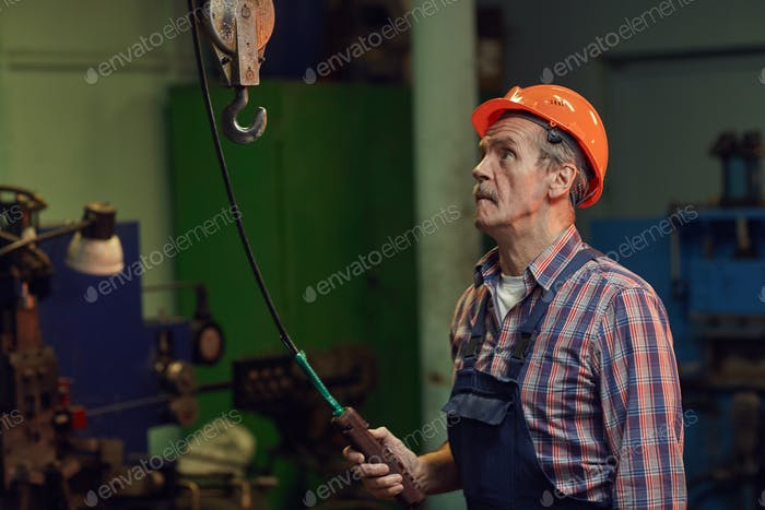 Construction worker in the factory