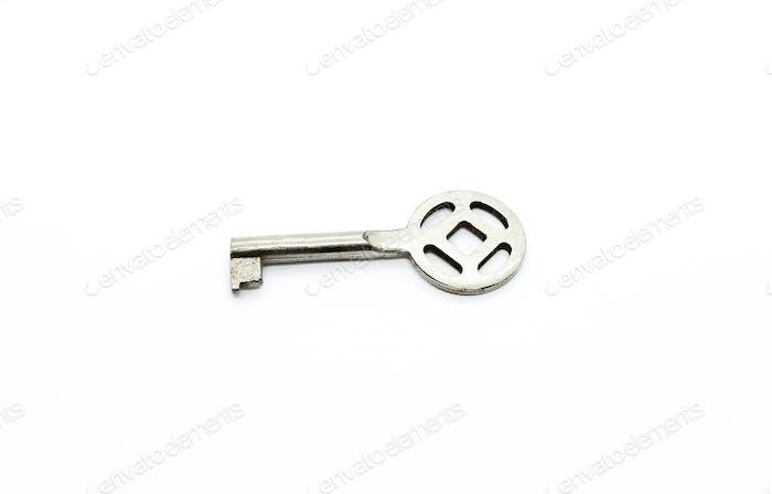 Silberner Schlüssel, isoliert auf weißem Hintergrund