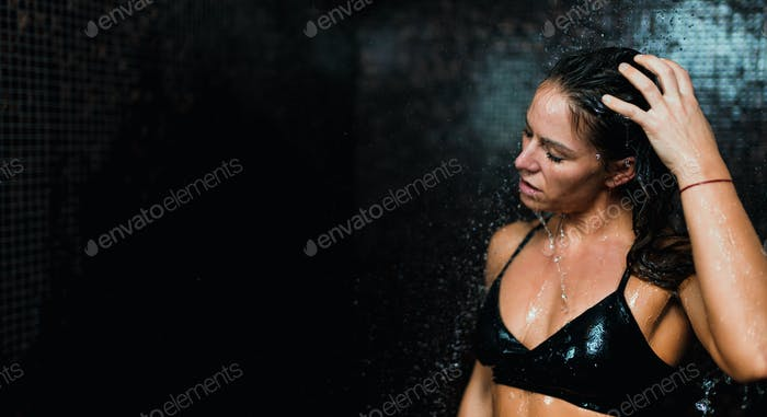 Woman under Shower Water Drops