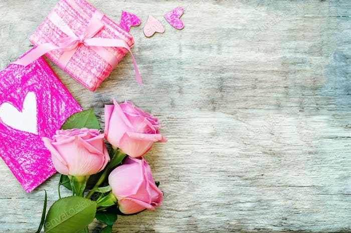 Valentine's background with a gift, flower and card