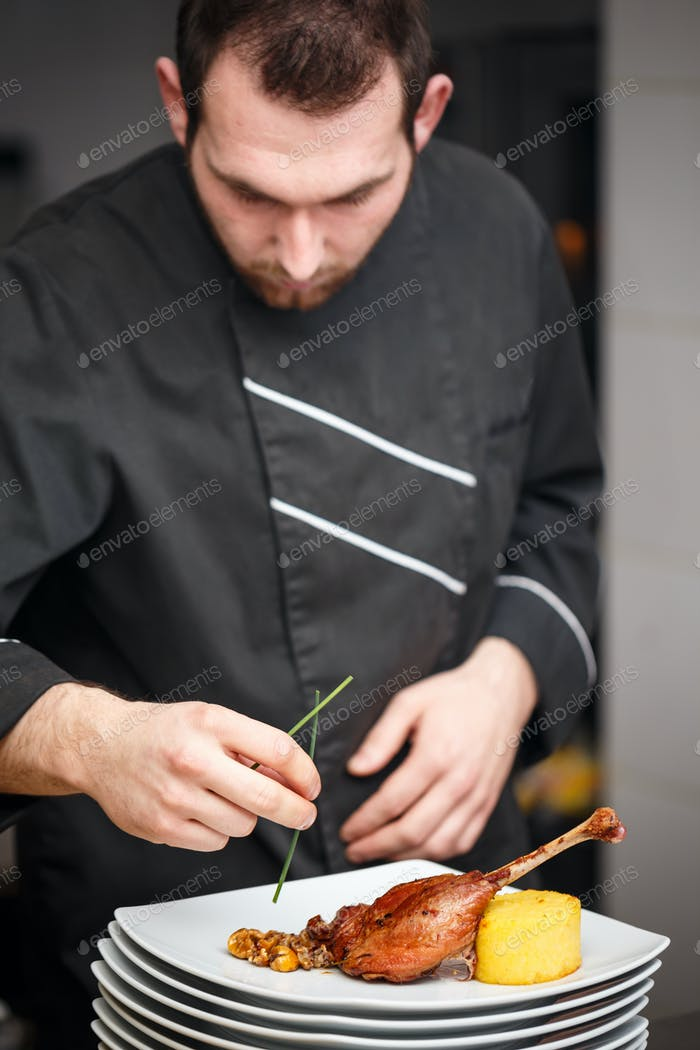 Chef is making meat dish