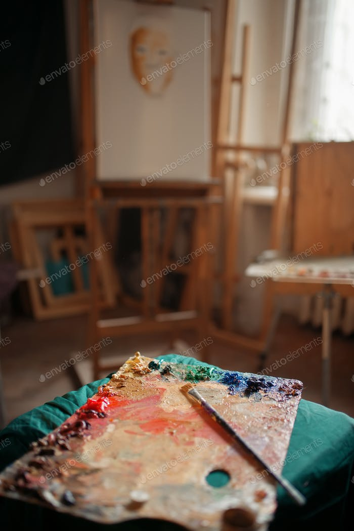 Color palette and brush, easel on background