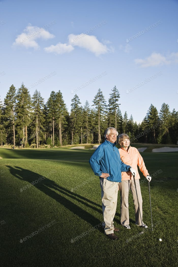 Senior golfing couple on the golf course.