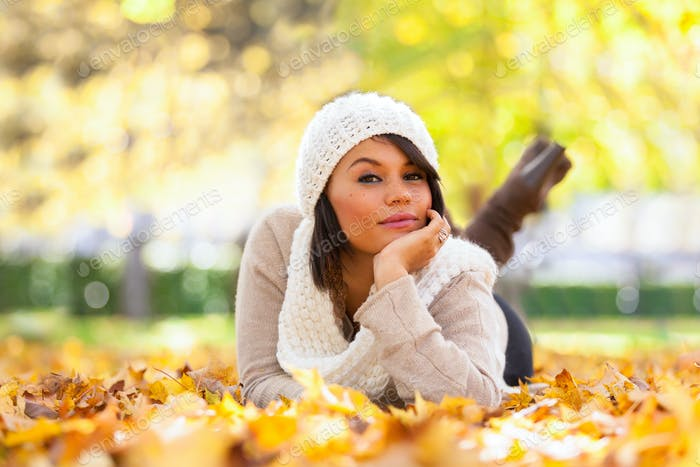 Autumn outdoor portrait of beautiful young woman - Caucasian peo