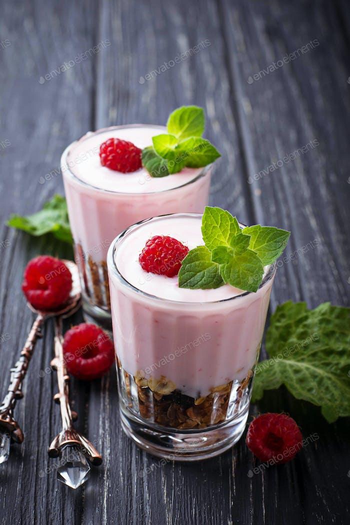 Dessert with granola, yogurt and raspberry