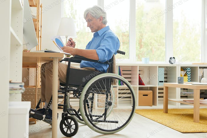Disabled man working at home