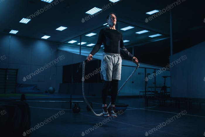 Active man on training, workout with rope