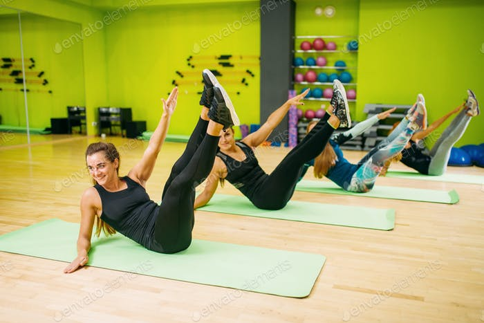 Women in sportswear, workout on mat for fitness