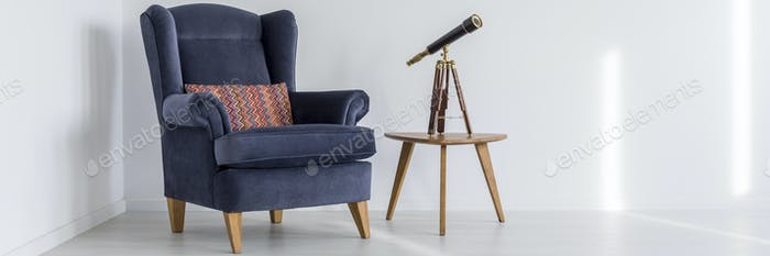 Armchair, table and telescope