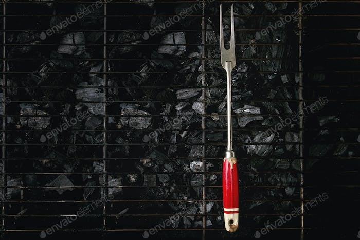Barbeque fork on charcoal