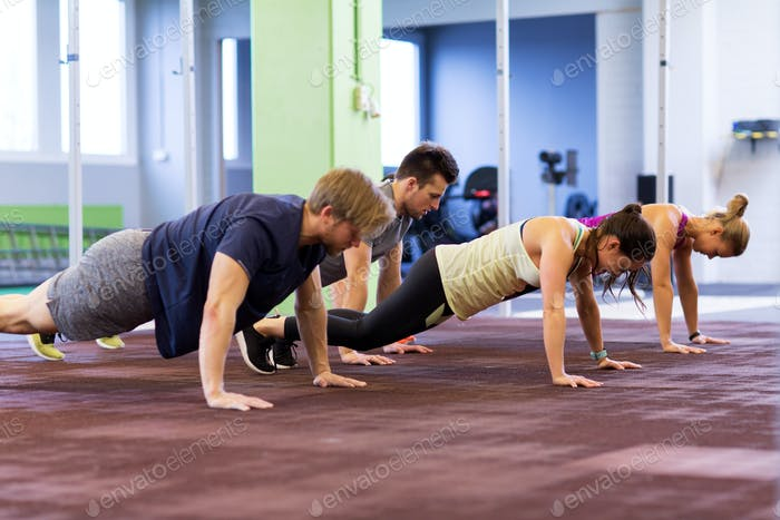 group of people exercising in gym